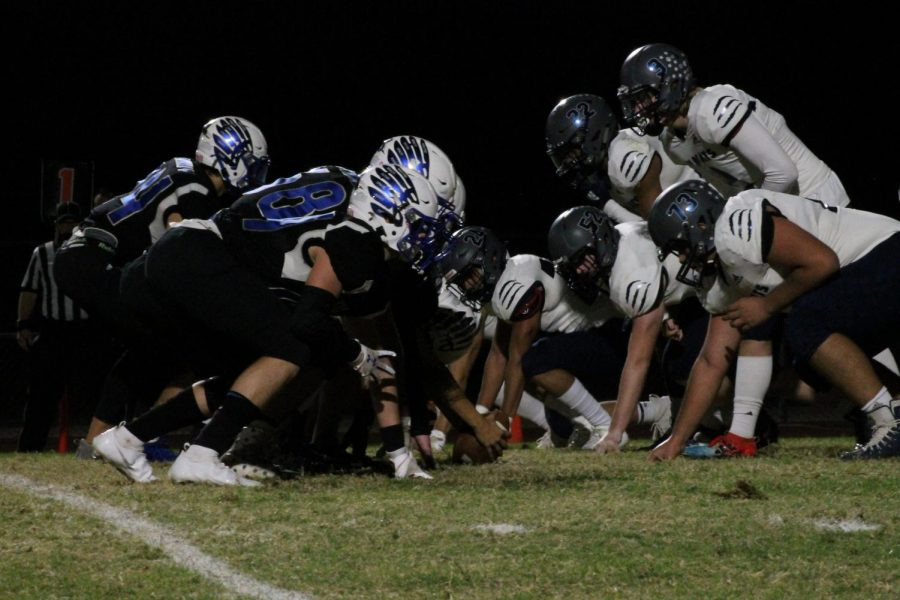 OHS football preparing for a play, facing off against Willow Canyon high school on Nov. 13.