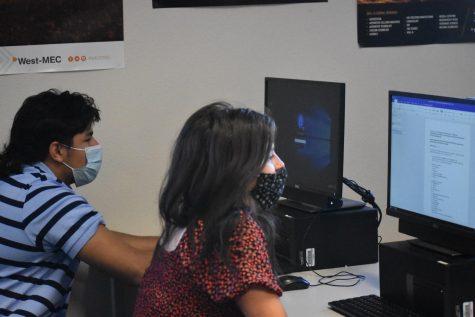 Arturo Whipple, sophomore (left), and Samantha Sharlot, sophomore, (right), working hard for FBLA.