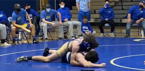 Joseph Riccelli, sophomore, pinning his opponent in a match against PHS.