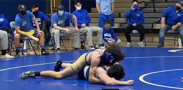 Joseph+Riccelli%2C+sophomore%2C+pinning+his+opponent+in+a+match+against+PHS.+