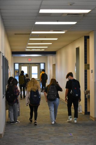 Students head to class on a new bell schedule.