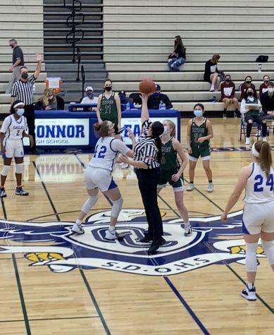 OC girls basketball in a tipoff in ridge rivalry game