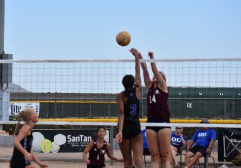 OHS beach volleyball winning their set against their rivals, MRHS.