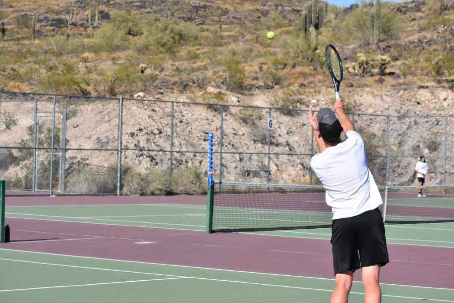 OHS tennis player practices for upcoming match.