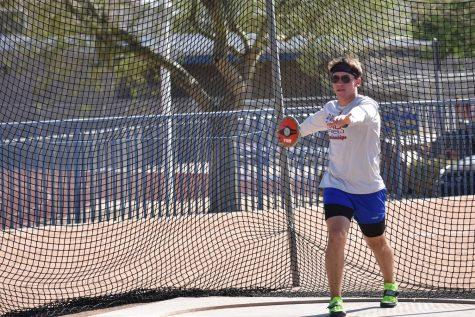 Patrick Fattu, junior, prepares to throw the discus.